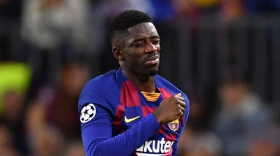 FILED - 27 November 2019, Spain, Barcelona: Football: Champions League, Group stage, Group F, Matchday 5, FC Barcelona - Borussia Dortmund at Camp Nou. Barcelona's Ousmane Dembele has to leave the court injured. (To dpa