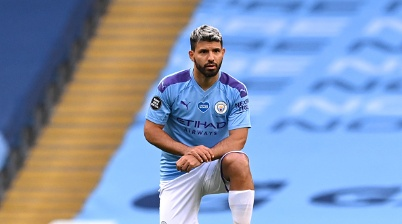 MANCHESTER, ENGLAND - JUNE 22: Sergio Aguero of Manchester City takes a knee in support of the Black Lives Matter movement during the Premier League match between Manchester City and Burnley FC at Etihad Stadium on June 22, 2020 in Manchester, England. Football stadiums around Europe remain empty due to the Coronavirus Pandemic as Government social distancing laws prohibit fans inside venus resulting in all fixtures being played behind closed doors. (Photo by Shaun Botterill/Getty Images)
