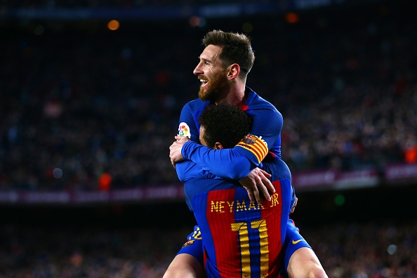 BARCELONA, SPAIN - MARCH 04:  Neymar of Barcelona celebrates with Lionel Messi after scoring their second goal during the La Liga match between FC Barcelona and RC Celta de Vigo at the Camp Nou on March 4, 2017 in Barcelona, Spain.  (Photo by Dan Istitene/Getty Images)
