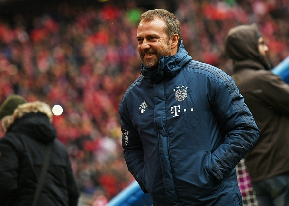 21 December 2019, Bavaria, Munich: Football: Bundesliga, Bayern Munich - VfL Wolfsburg, 17th matchday in the Allianz Arena. Munich coach Hansi Flick comes to the game. Photo: Angelika Warmuth/dpa - IMPORTANT NOTE: In accordance with the regulations of the DFL Deutsche Fu?ball Liga and the DFB Deutscher Fu?ball-Bund, it is prohibited to exploit or have exploited in the stadium and/or from the game taken photographs in the form of sequence images and/or video-like photo series. (Photo by Angelika Warmuth/picture alliance via Getty Images)