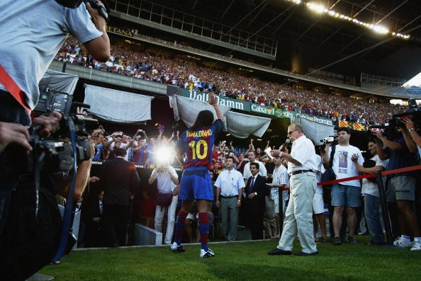 BARCELONA - JULY 21:  Ronaldinho of Brazil waves to the fans during the Barcelona FC Press Conference for the signing of new player Ronaldinho on July 21, 2003 at the Nou Camp in Barcelona, Spain. (Photo By Shaun Botterill/Getty Images)